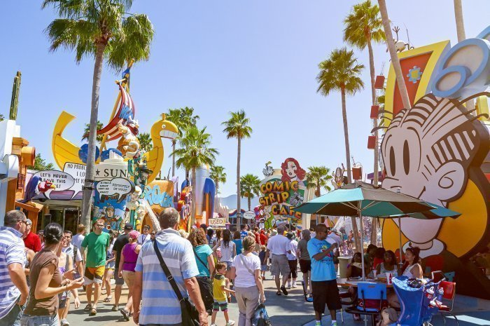 Florida Universal studio street with visitors in orlando in sunny clear day. Family visiting amusement park